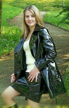 girl wearing shiny vinyl / pvc coat and skirt in the public park Vinyl Raincoat, Pvc Raincoat, Pvc Fashion, Womens Fashion, Mode Latex, Pvc Skirt, Vinyl Dress, Vinyl Clothing, Raincoat Jacket