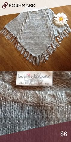 🌸Bobbie Brooks Girls Poncho🌸 Young Girls Bobbie Brooks Poncho🌸New/Never Worn🌸Tag Attached🌸Gray/White Sweater Poncho with Silver Shimmer🌸Size tag states XL (14/16) in my opinion fits more like a 8/10/12🌸100% Acrylic 🌸Bobbie Brooks🌸 Jackets & Coats Capes