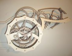 Wooden gear clocks, clock kits, and do-it-yourself clock plans. These original all-wood clocks are functional, attractive, and fun! Wooden Gear Clock, Wooden Gears, Wall Clock Kits, Clocks, Steampunk, Woodworking, House Design, Crafts, Accessories