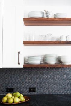 grey penny tile backsplash, black marble countertop, open shelves