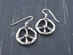 Bring out your inner hippie with a set of Peace Sign #earrings. islandcowgirl.com #handmadejewelry