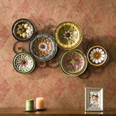Planning on a display of some of my plates on the walls downstairs... not my plates, but you get the idea!  Love this holder!