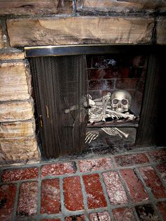 Skeleton in the fireplace.  Clever