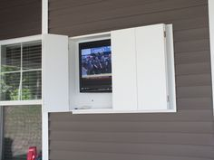 Outdoor TV cabinet made from weatherproof PVC.