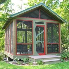 Freestanding screen porch.  I LOVE the door!  If this had a grill or other equipment for a cookout, this could be considered a