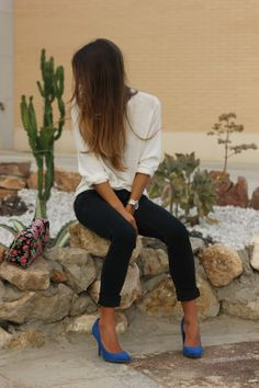 White blouse, black jeans, and a pop of color.