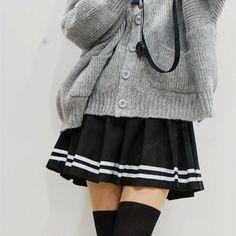 Grey cardigan, black pleated mini skirt, over the knee socks