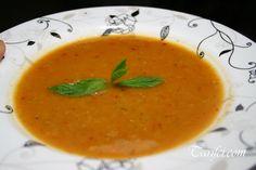 Kırmızı Mercimek Çorbası (red lentil soup) 1 medium onion, chopped  1 large potato, chopped  1 carrot, chopped  2 tbsp oil  1 tbsp tomato paste  1 cup red lentil, washed and drained  6-7 cups hot water ( you can add 1 cube of beef bouillon)  1 tbsp salt  A pinch of dry mint(optional)    Garnish:  2 tbsp butter  1 tbsp red pepper  A pinch of salt  You can use hot red pepper if you like.