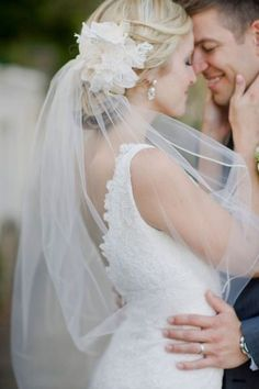 Perfect example of a simple dress, simple veil, and the flower I'd like in my hair with a low updo (or side updo)!