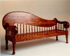 Replica of The Queen's Clef bench made out of Koa wood from the Big Island by Martin and Macarthur.