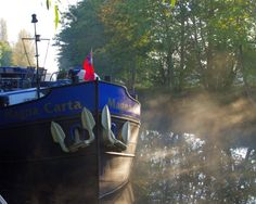 Hotel barge 'Magna Carta moored' on the Royal River Thames.
