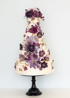 Featured Cake: Rosalind Miller Cakes; Romantic purple flower covered wedding cake; Featured Cake: Rosalind Miller Cakes