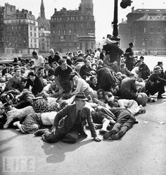 Sep 01, 1944    Crowd of frightened Parisians ducking down on the pavement on Pont d'Arcole bridge to evade German sniper fire following the Nazi surrender of city to Free French forces under Gen. Charles De Gaulle (Photo by Frank Scherschel//Time Life Pictures/Getty Images)