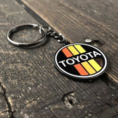 Show off your Toyota pride with this handsome crafted metallic and enamel keychain, styled in the retro Toyota racing colors we here at Wicked Wheeler have been fond of since 2013.
