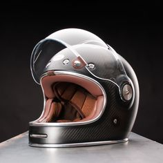 - Description - Details - Videos The newest iteration of the overwhelmingly popular Bell Bullitt Helmet, the Carbon boasts significantly reduced weight and undeniable style. Birthed from an industrial