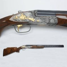 Perazzi Over Under Sporting Clay Shotgun - While Perazzi is known for their quality sporting grade shotguns, they are also valued by collectors for their high-grade luxury pieces, many finely engraved constructed with the exceptional Italian craftsmanship that embodies some of the world's finest scatter guns. This Perazzi is a 12 ga over/under that depicts a scene from the American West, with cowboy and Indian figures engraved and rendered in gold. NRA National Firearms Museum in Fairfax…