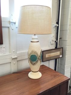 Mid Century Modern ceramic lamp. New wiring and shade. Available at Mid Mod Collective. Email midmodcollective@gmail.com for more info.