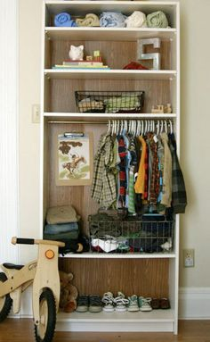 open closet from an inexpensive bookcase in a small space. be sure to paint or wallpaper the inside for a custom feel.