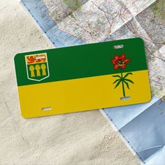 Shop Saskatchewan flag license plate created by AwesomeFlags. Make Your Own Flag, How To Make, Car Flags, Hug, Great Gifts, Plates, Cars, Sports, Stickers