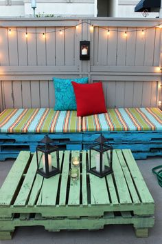 Love this look for an outdoor space. Bet you could D-I-Y the table yourself with some paint and by giving it a distressed look.