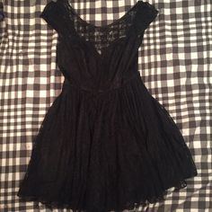 Black sweetheart lace neckline dress sz med (Not asos, bought at an online boutique called blue juice) selling because it's too big on me. Would fit a size 4-6. Very cute and flirty skirt.only worn once. ASOS Dresses Mini