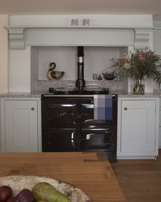 Classic English cabinetry surround a classic black Aga! This beautiful kitchen is painted in Farrow & Ball Theresa's Green with a Sardinia Grey granite worksurface. Aga Kitchen, Kitchen Dinning, Kitchen Worktop, Kitchen Ideas, Dining, Beautiful Kitchens, Cool Kitchens, Black Kitchens, Aga Surround