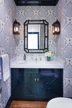 Powder room with navy lacquered cabinet | Ann Lowengart Interiors