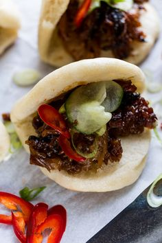 Super tender, sticky and sweet pork belly with a hit of chilli and pickle all wrapped up in a soft fluffy steamed bun.