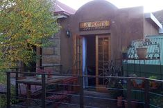 La Poste Apartment - Accommodation in Clarens. Clarens Self Catering Apartment, Flatlet Accommodation, Northern & Eastern Free State, Free State, South Africa Open Plan Apartment, Coffee Restaurants, Abseiling, Free State, Bespoke Furniture, Rooftop, Entrance, Cottage, Patio