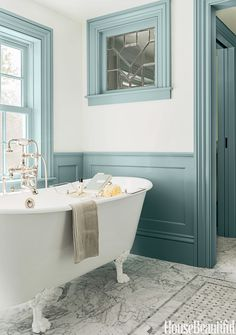 "Back in the 18th-century when this Massachusetts farmhouse was built, there was no such thing as a master bath. So architect Michael T. Gray and interior designer Hattie Holland, both of Carpenter & MacNeille, carved one out of a hallway and added wainscoting and window casings to create a sense of the past. Painted a deep blue-gray, they stand out against the pale blue walls. The color ""has a historic feeling with that gray cast and plays off the Carrara marble so well,"" Holland says. In…"