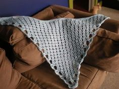http://otherrandominterests.blogspot.com/2008/08/broomstick-lace-shawl-pattern-its-here.html calls this beautiful triangular broomstick lace shawl the Meryle shawl (after the author's Mother-In-Law)