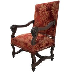 French Renaissance Revival Walnut Fauteuil, C. late 1800's. Grotesques carved on the arms.  Only $ 2,995