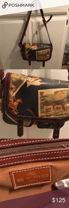 ETRO Ladies Handbag Lovely leather handbag. The print is of dogs and horses . 2 large front pockets , clasp closure . Color is variable but mostly greens and tans . Etro Bags Shoulder Bags