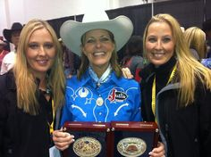 World champion barrel racer, Mary Walker, poses with On The Rodeo Road owners, Leigh and Anne Walkup, after her 2012 win in Vegas.