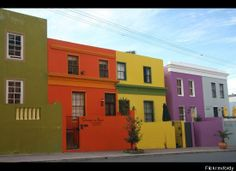 This psychedelic neighbourhood in Cape Town, South Africa used to be called the Malay Quarter. Multi-coloured homes and cobblestone streets define this quaint area which should be marked on every Cape Town itinerary. Location Scout, Colourful Buildings, Cape Town South Africa, Beaches In The World, Living In New York, Most Beautiful Beaches, World Of Color, Rue, Luxury Travel