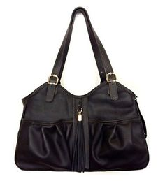 Introducing the Metro Couture Bag Collection from Petote. The leather trim and all leather Metro Couture bag, is available in all leather Midnight Black (tan stitch) with Tassel detail. http://www.chicpooch.com/petote-metro-couture-midnight-leather-with-tassel-pet-carrier.html