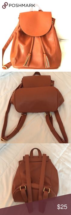 Old navy backpack FLASH SALE! Faux leather cognac drawstring back pack with gold details. Used once so practically new! Very clean and smoke free. No rips or stains. Old Navy Bags Backpacks