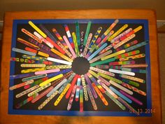 """A piece I made for my Sociology final, where I was given the assignment to """"change the world.""""  I volunteered at a nursing home and had some of the residents paint a few craft sticks each.  My siblings' school also made some.  I then glued the crafts sticks onto a foam core board, framed it, and it will be hung on a wall in the nursing home for the residents that made it to see everyday and hopefully feel proud of what they did."""
