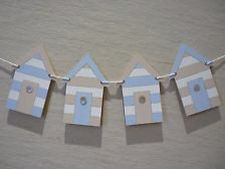 Handmade wooden bunting in the following styles: apples, beach hut, boat, butterfly, camper van, crown, cupcake, flag, flower, gingerbread men, heart, house, lighthouse, pram, robot, rocking horse, skull and crossbones, star, teapot, teddy bear, toadstool, train and Tutu!  See facebook.com/memorablemomentsgifts for further details