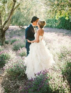 a romantic kiss while surrounded by fields of lavender