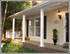 weekend porch makeover, curb appeal, lighting, porches, So much better The best part The makeover cost 150 Budget decorating love it Home Porch, Diy Porch, Porch Ideas, Yard Ideas, Pictures Of Porches, Porch Railing Designs, Front Porch Posts, Brick Steps, Porch Columns
