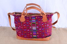 Support fair trade with this handmade Guatemalan double sided embroidered purse finished in leather.  Check out this item in my Etsy shop https://www.etsy.com/listing/212872533/purple-embroidery-guatemalan-fabric