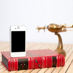 How completely kewl is this?! I love that this is a real book that was made into a dock, a very surreal Farhenheit 451 if you will! Even though I am one of those neanderthals who does not have ipad or an iphone, I do need to replace my ipod and this would be the best dock evea!!!