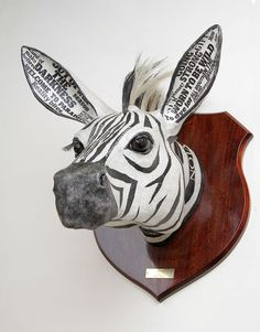 These brilliantly original Animal Heads are mounted but not stuffed. Ideal statement wall hangings of various African animal sculptures made from paper-mache