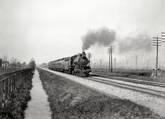 """Circa 1905. """"Pennsylvania Flyer, eastbound."""" Heading past Telegraph Pole National Forest. 8x10 inch glass negative, Detroit Publishing Co."""
