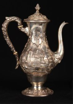 S. Kirk & Son Co. Sterling Silver Chocolate Pot. Hand chased repousse sterling silver pot with Renaissance revival landscape and floral motif. Height 9 3/4 inches.