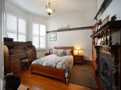 Lovely room, with original cast-iron fireplace, mantle, bay window, polished boards, picture rail - 24 Hiller Street, Devonport, Tas 7310