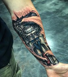 TATTO IDEAS & INSPIRATIONS Mens biomechanical forearm piece by Roman Abrego, an artist based in Yucaipa, California.