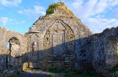 """Ballinakill Abbey   Archaeologists say that this oval shaped, hill-top site was an """"early ecclesiastical enclosure"""", probably dating back to the 5th 0r 6th century. Ballinakill is taken from the Irish townland name of Balli-na-cille, the place of the Church.   Little remains of this Church except for the east wall. It is reputed to have been the first gothic Church in Connacht."""