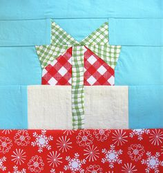 Big bow on presents. Makes a great block or mug rug.
